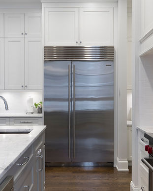 stainless-steel-refrigerator-beside-whit