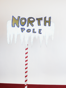 north pole gold letters .png