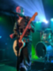 An image of Tug performing live.