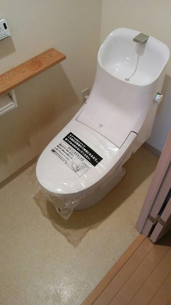 尼崎市 INAX ベーシア一体型 シャワートイレ、ウォシュレット