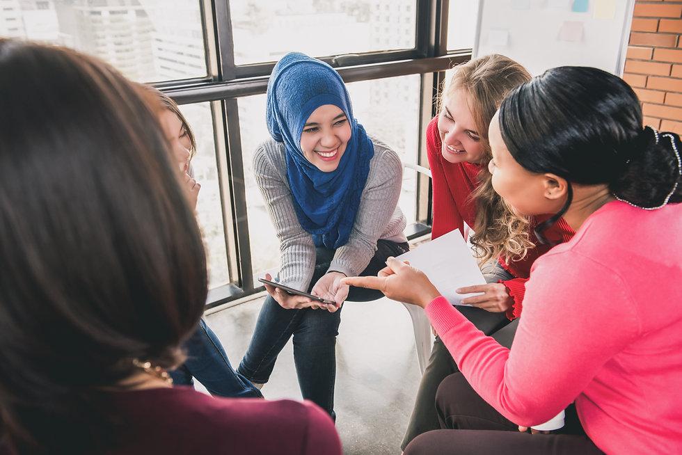 Diverse women sitting in circle enjoying