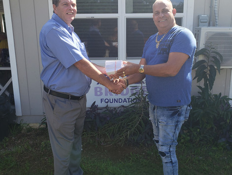 Rotary Central Donates Food Cards to the Bridge Foundation