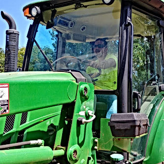 CHARLES IN TRACTOR.jpg