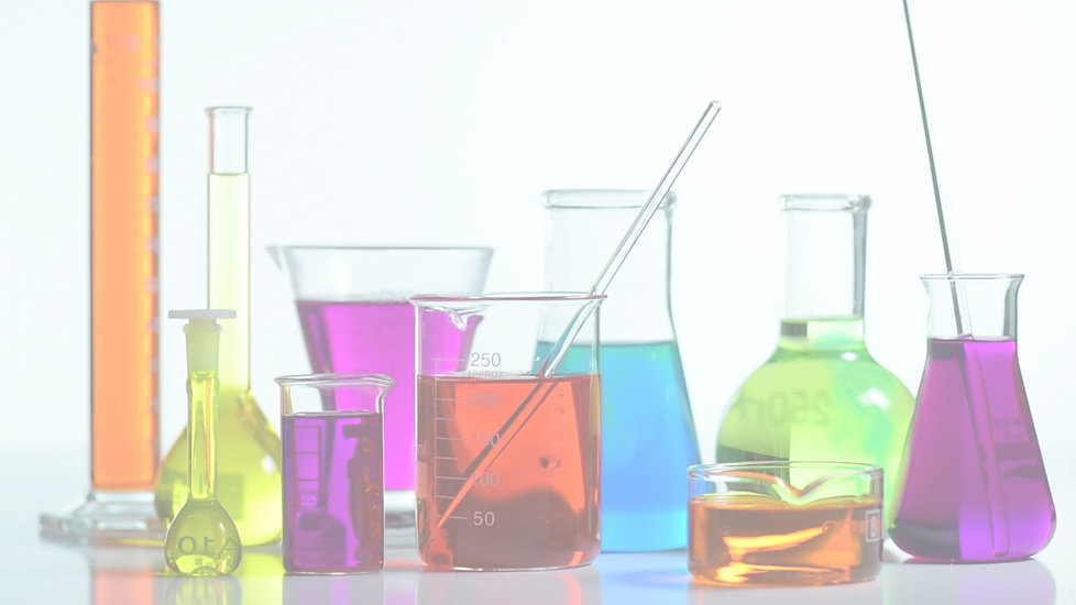 chemistry beakers filled with coloful liquids