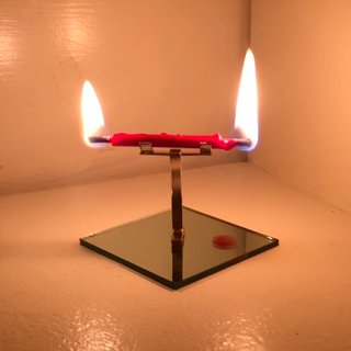 Mirrored Candle Burning at Both Ends, NFS