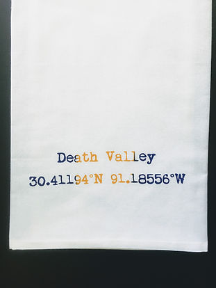 DEATH VALLEY COORDINATES TEA TOWEL PURPLE AND GOLD
