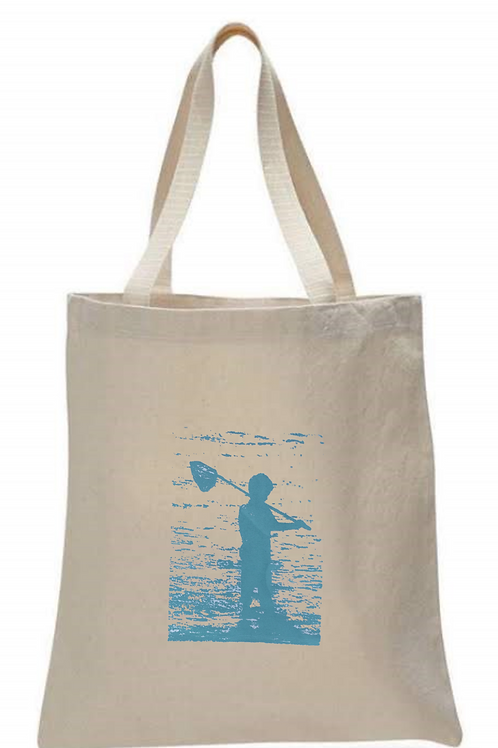 BOY FISHING ON BEACH WITH NET TOTE BAG