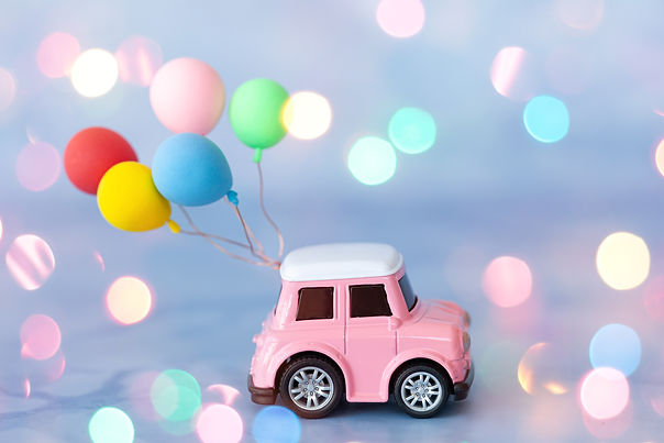 Little toy car with colorful ballons and