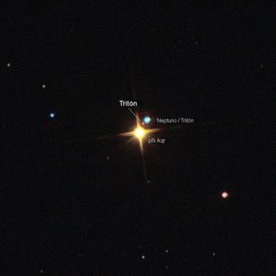 Neptuno y su luna Tritón