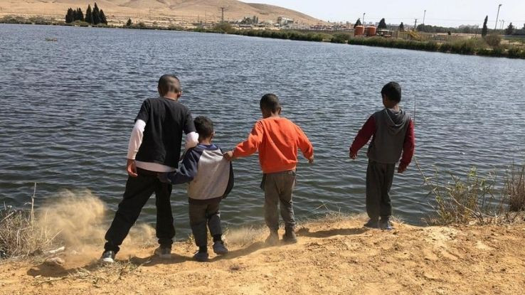 Children on the shores of unfenced ponds