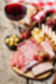 Glass of red wine with charcuterie assor