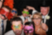 family in a photo booth that left a photo booth rental review for party time photo booths