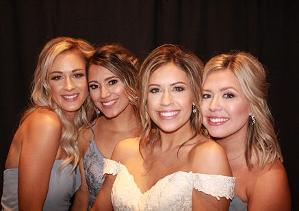 bride and bridesmaids in a photo booth at a wedding in Dallas