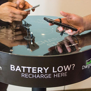 cell phone charging table with 2 people charging phones