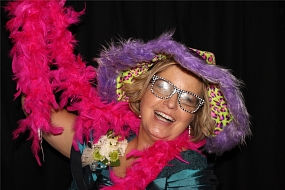 woman wearing props taking pictures in a photo booth that left a review