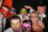 bride and groom in photo booth for rental review