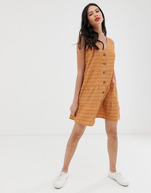 ASOS DESIGN sleeveless button through tiered smock mini dress $22.50$50.00