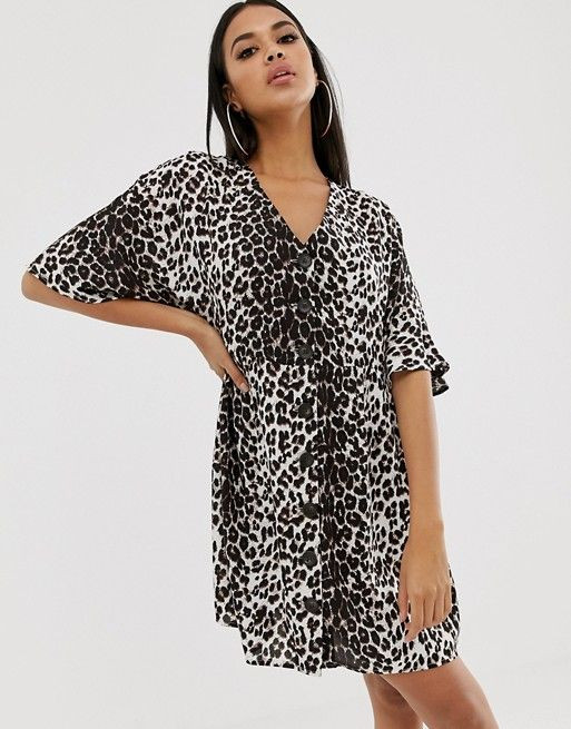 ASOS DESIGN v neck button through mini smock dress in leopard print $25.50$64.00