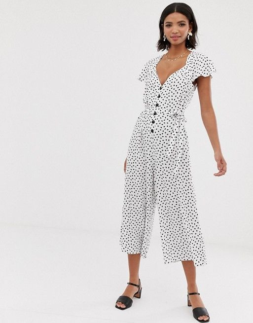 ASOS DESIGN flutter sleeve spot print jumpsuit with button front $41.50$76.00