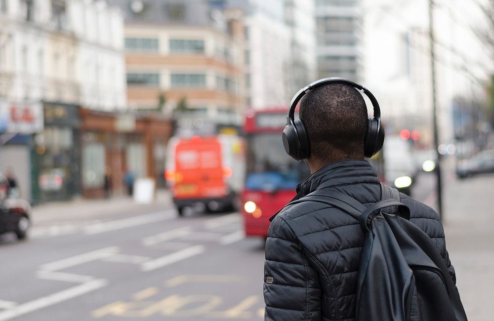 man with headphones on street