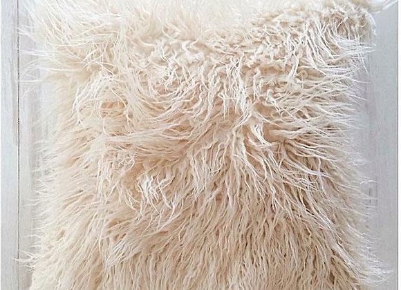 Cojín Furry (en varios tonos).
