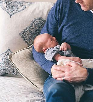 Man Holding Newborn