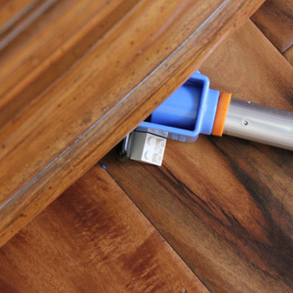 Tool for reaching under low furniture and cabinets on floor.