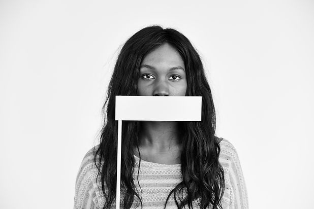 african-descent-covering-mouth-voiceless