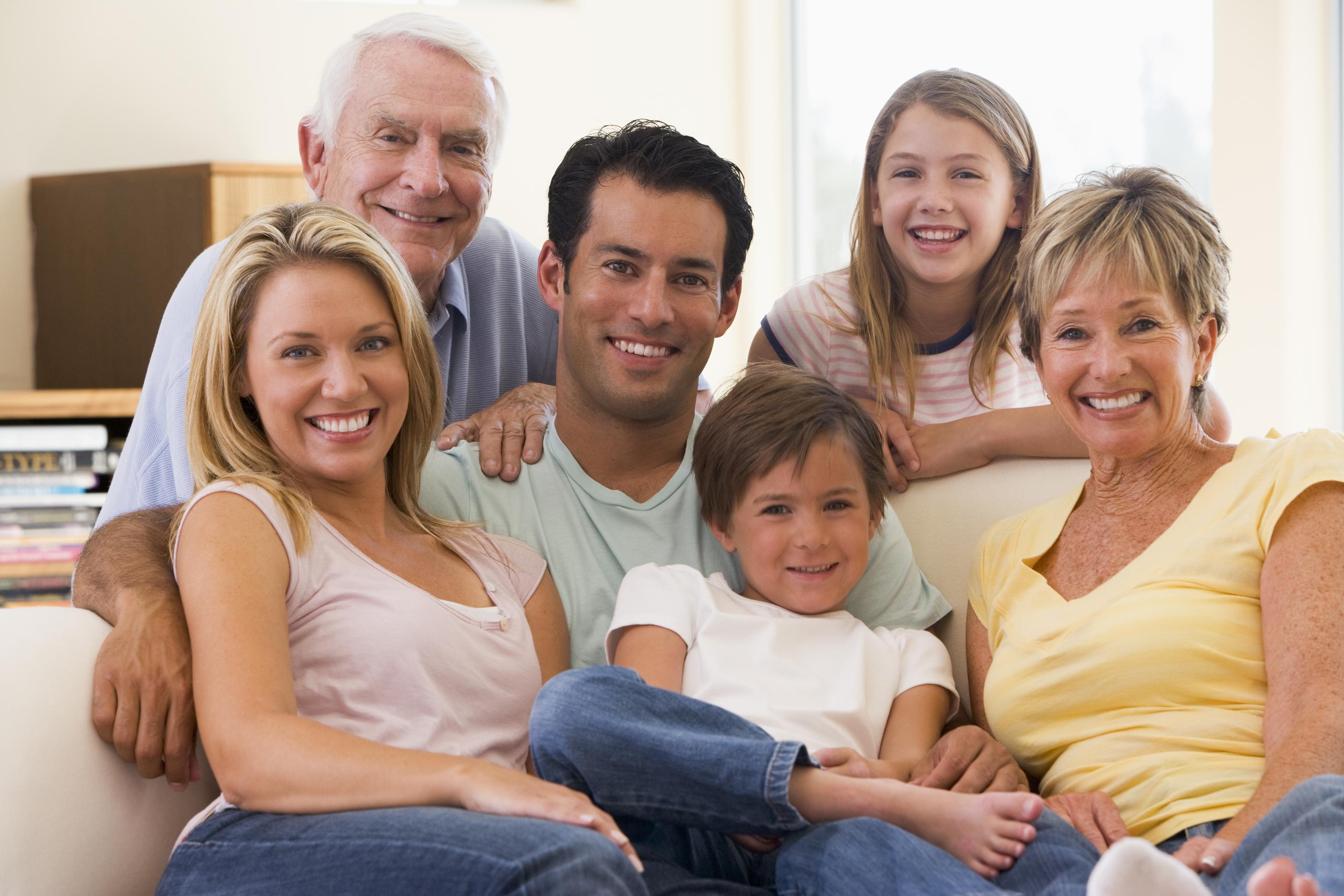 Extended Families In Living Room Smiling.jpg