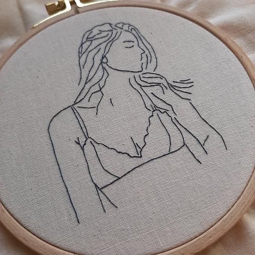 Kit à broder : la dame en soutien-gorge