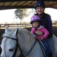 Erin and baby on pony.jpg