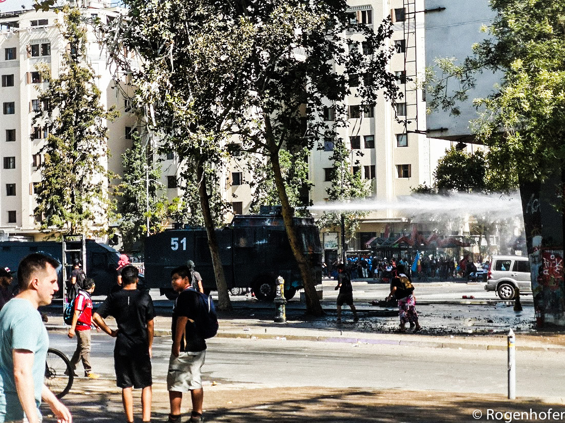 Water cannons are used against the protesters.