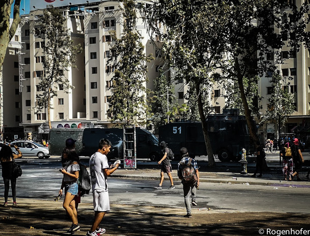Protesters clash with police in central Chile.