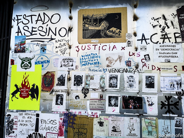 This wall shows alleged victims of what is referred to as a murderous state as well as calls for justice.