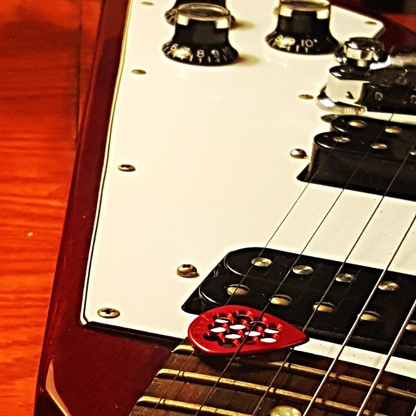 Red guitar pick