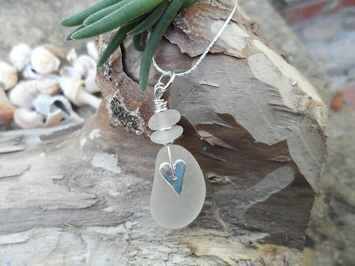 Beautiful soft white sea glass pendant with solid silver heart