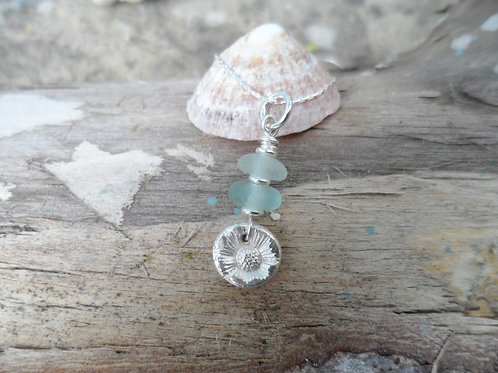 Silver flower with delicate blue sea glass pendant
