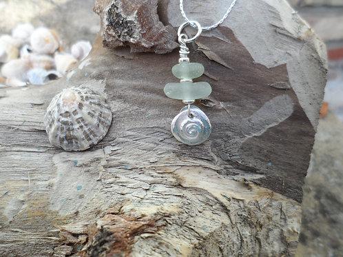 Pretty soft blues sea glass pendant with silver swirl