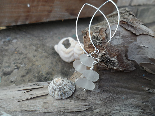 Sterling silver drop earring with soft white sea glass