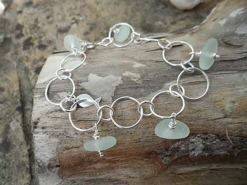Gorgeous soft blue sea glass bracelet with fish charm