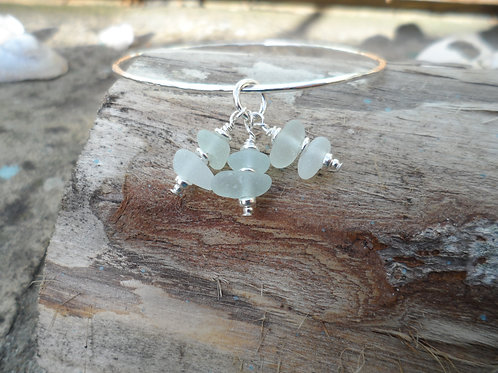 Gorgeous sterling silver bangle with delicate soft blue sea glass
