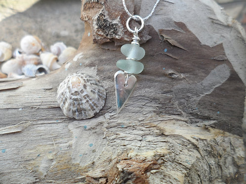 Delicate heart pendant with soft blue sea glass