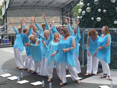 Choir laugh Robina sing sisters.jpg