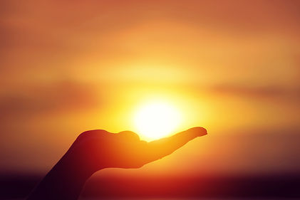 Sun on female hand. Silhouette of hand h