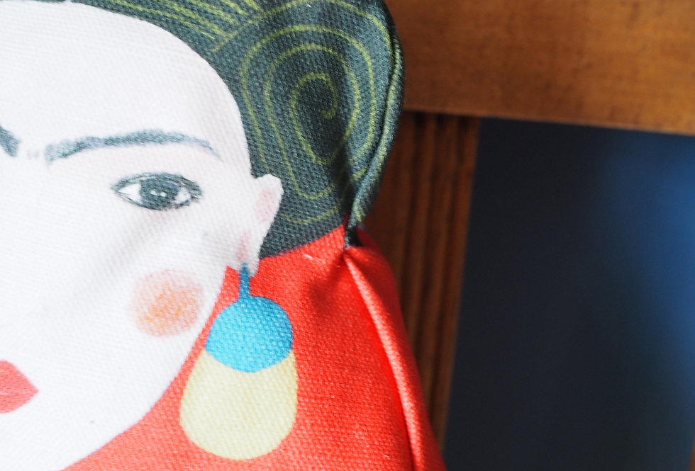 Frida with a kitty doll cushion.