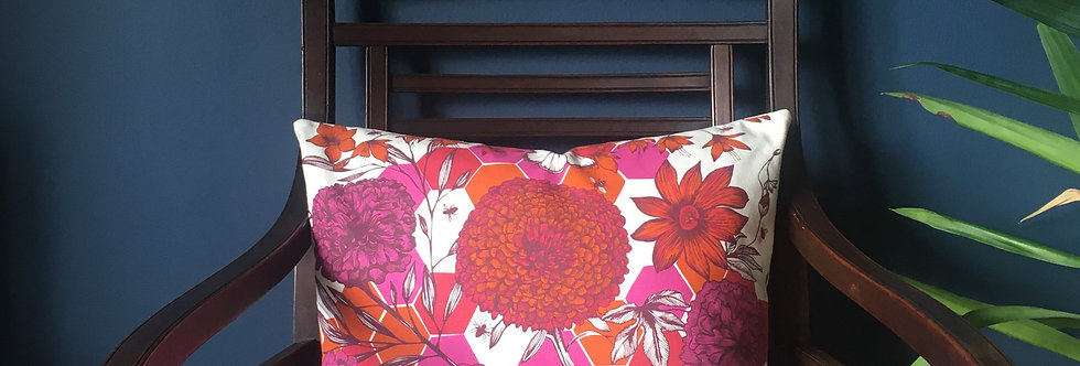 Funky pink and orange floral cushion