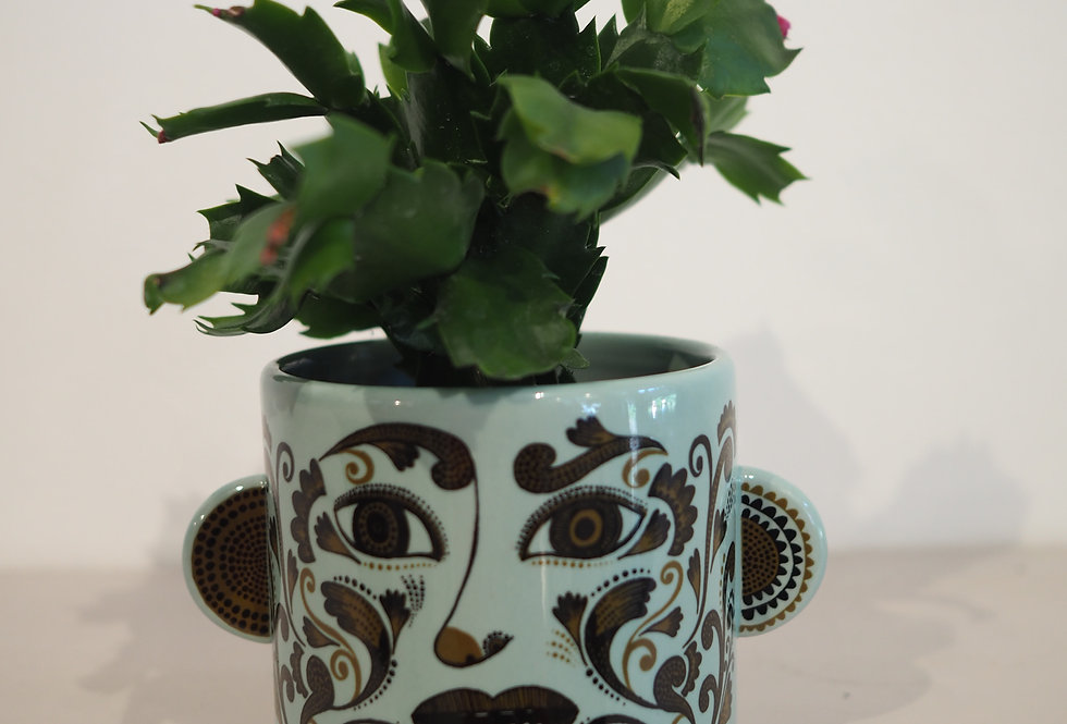 Funky plant person with ornate face - Lush