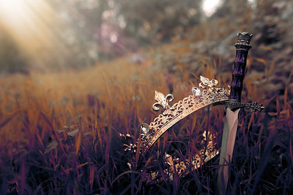 Crown with sword in field - shutterstock