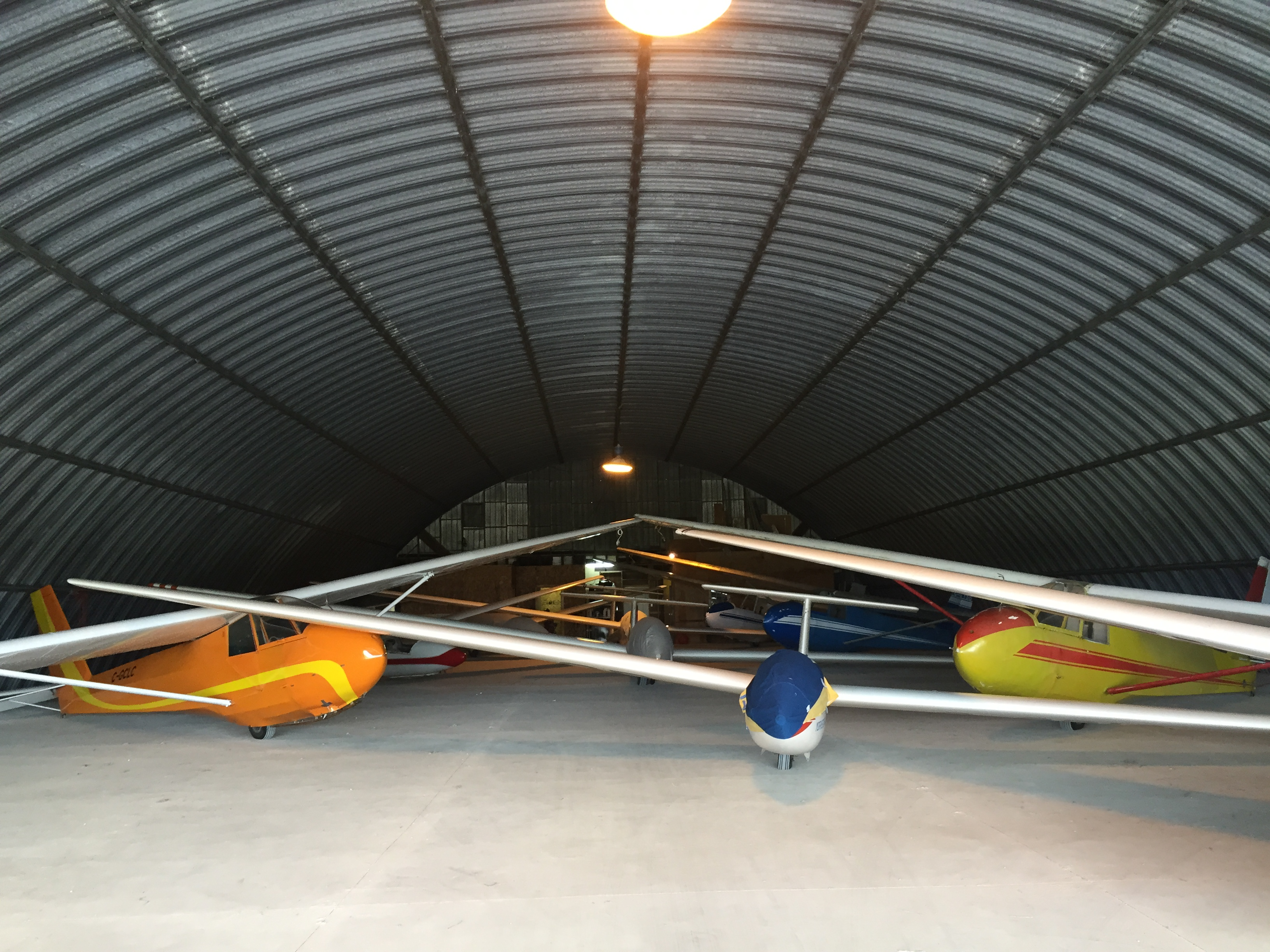 Gliders in a hangar.