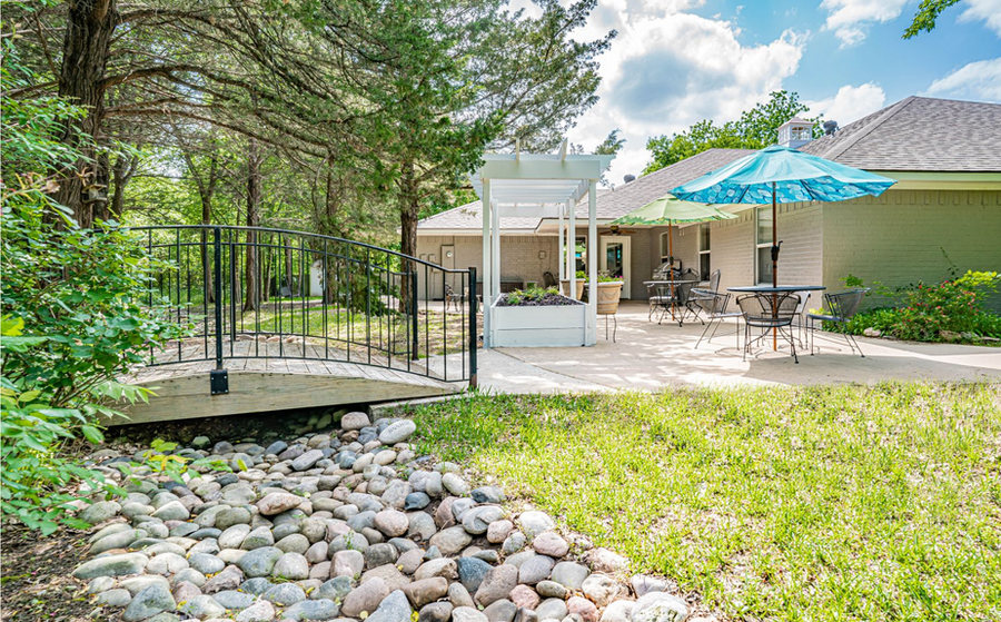 Easy access bridge from patio to wooded area